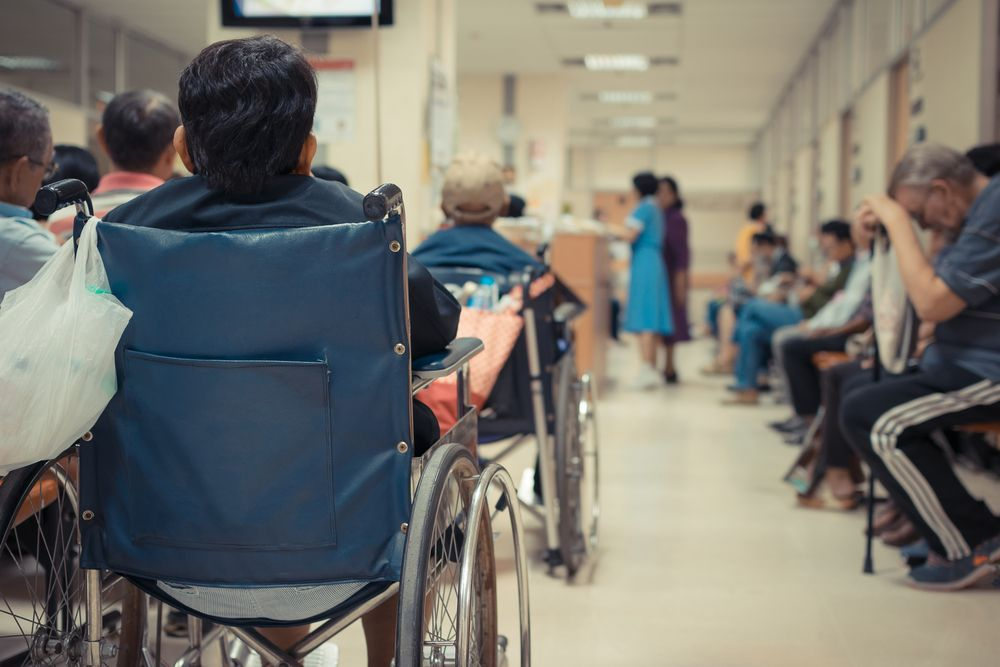 Several people lined up in the hospital. | Source: Shutterstock