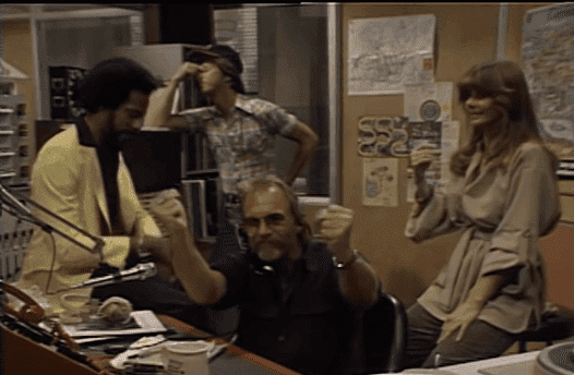 Staff at the WKRP radio station anxious as Les reports the news. | Source: YouTube/Shout! Factory.