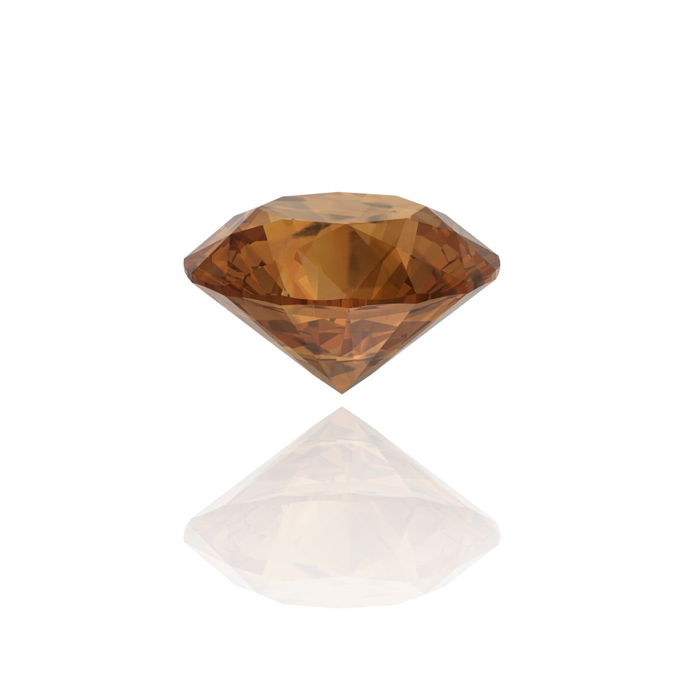 A photo of a brown diamond on white background. | Photo: Shutterstock.