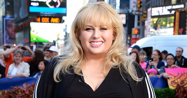 Rebel Wilson Flaunts Slimmed-down Figure in a Tight Sweater Onesie in Snaps Posing in Snow