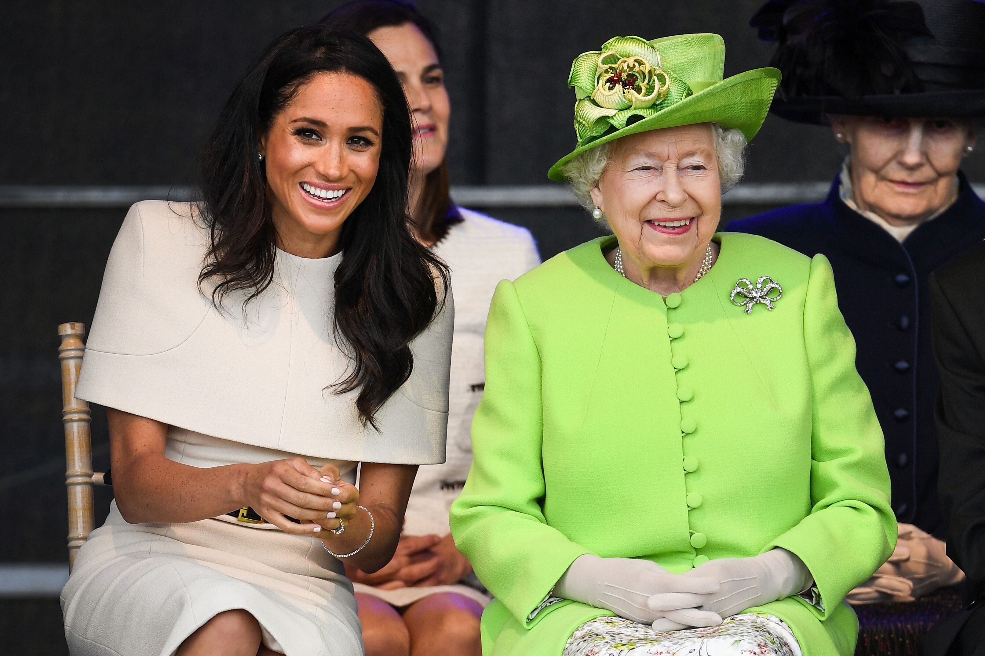 Queen Elizabeth II sits with Meghan, Duchess of Sussex during a ceremony to open the new Mersey Gateway Bridge on June 14, 2018 | Photo: Getty Images