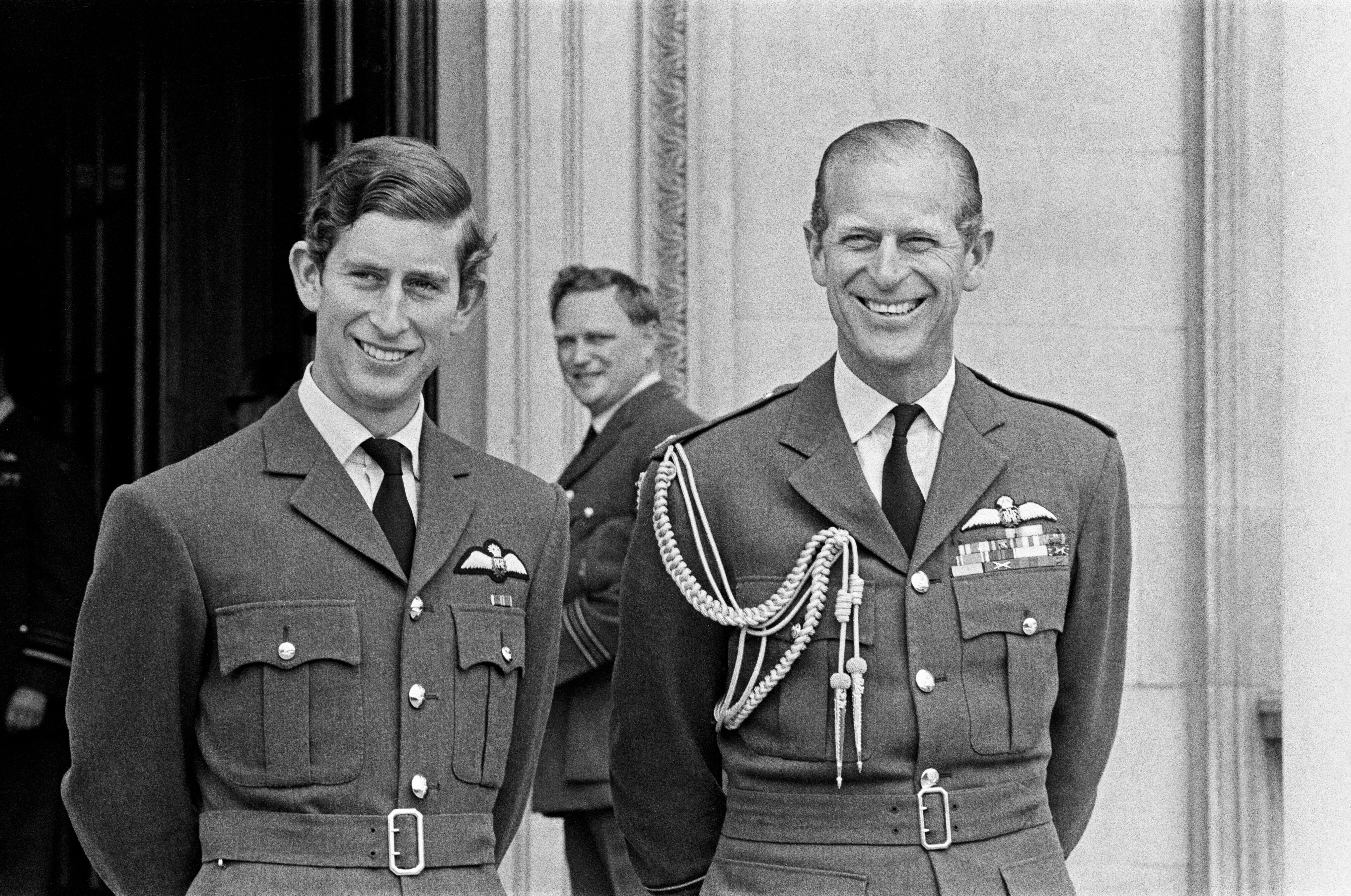 Prince Charles and Prince Philip wearing RAF uniform at the passing out parade at Cranwell in September 1971 | Source: Getty Images