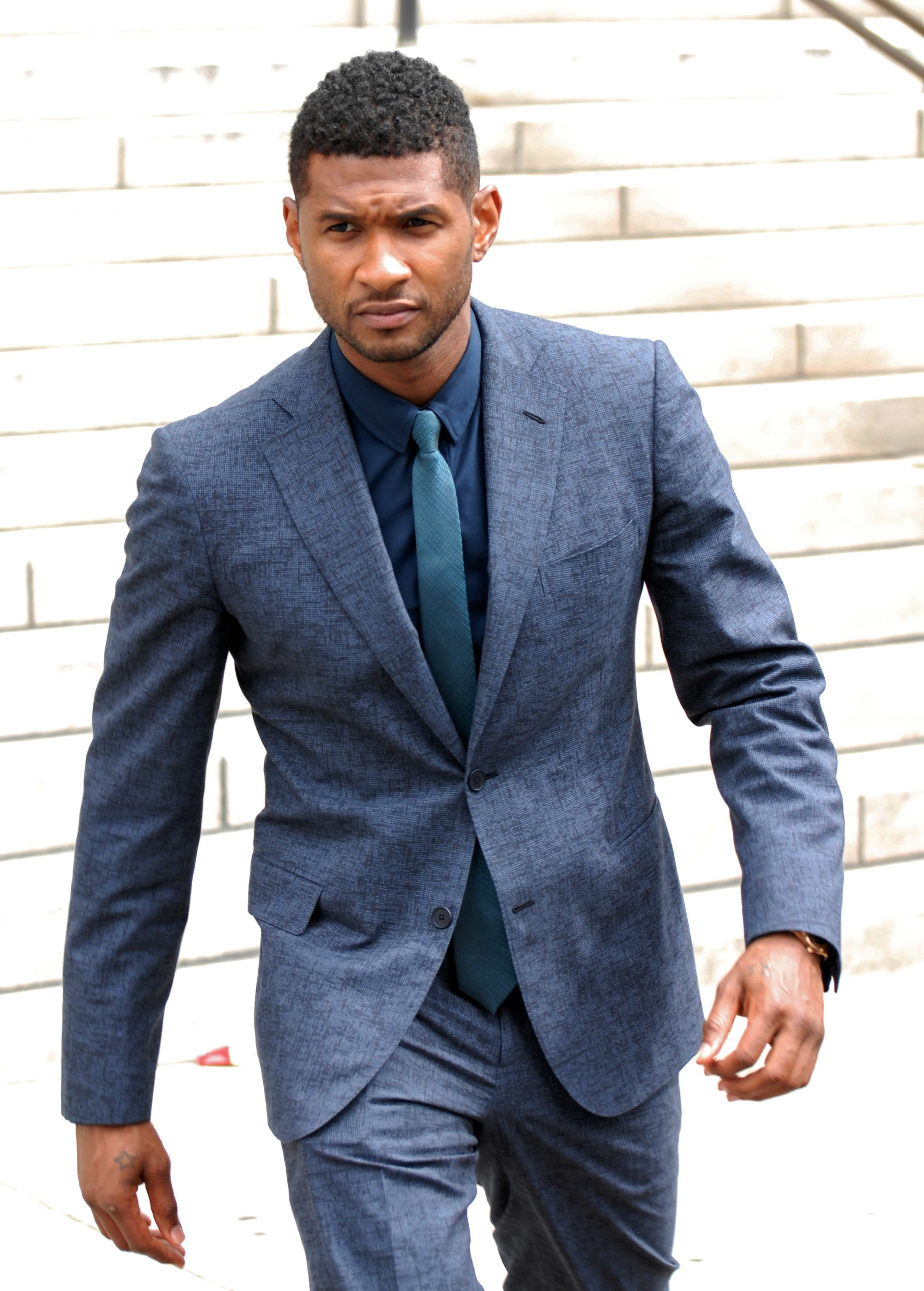 Usher Raymond attends a child custody meeting at Fulton County State Court on August 15, 2012 | Source: Getty Images