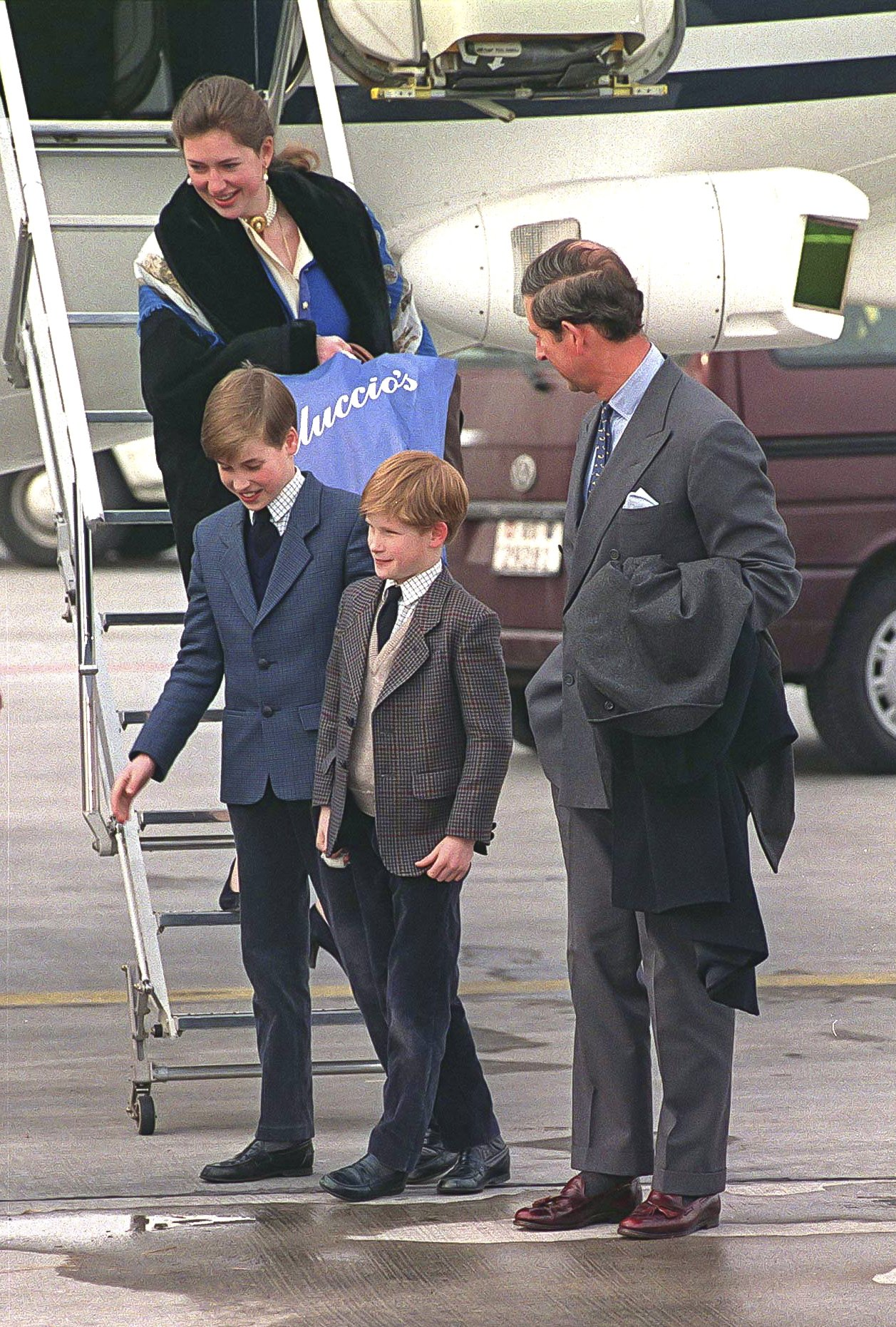 Prince Charles and Prince Harry standing with father Princes Charles and their Royal Nanny Tiggy Legge-Bourke at the Zurich Airport on February 17, 1994 | Photo: Getty Images
