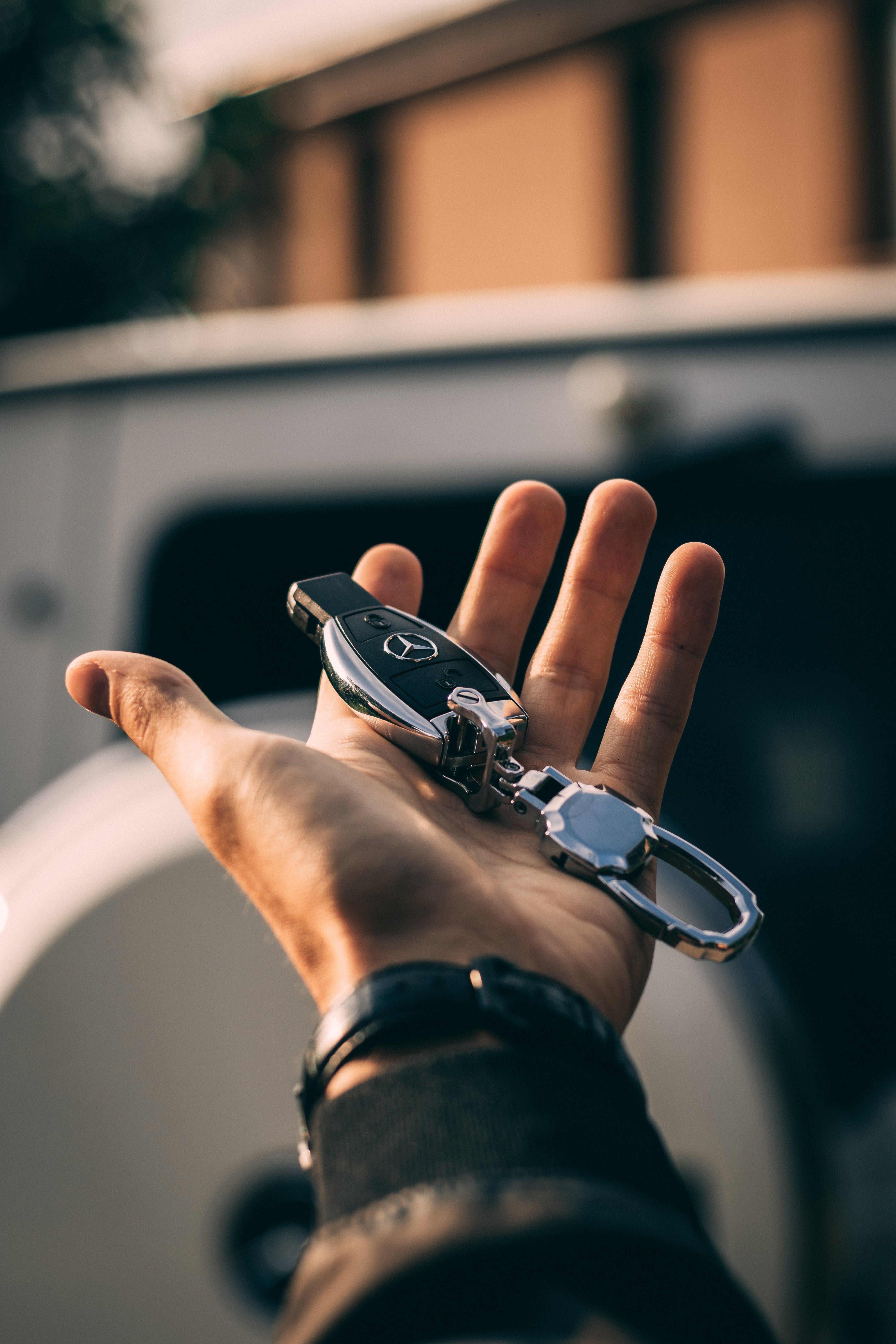A Mercedes car key on the palm of a hand | Source: Unsplash.com