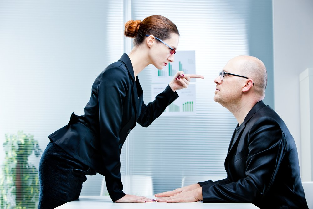 A bossy woman instructing a man. | Photo: Shutterstock