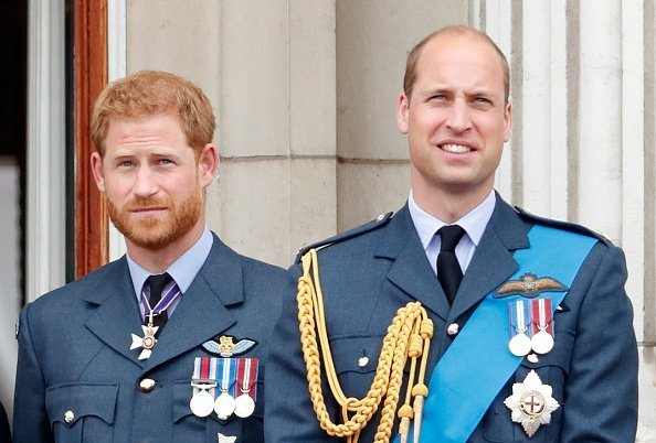 Prince Harry, Duke of Sussex and Prince William, Duke of Cambridge watch a flypast to mark the centenary of the Royal Air Force from the balcony of Buckingham Palace | Photo: Getty Images