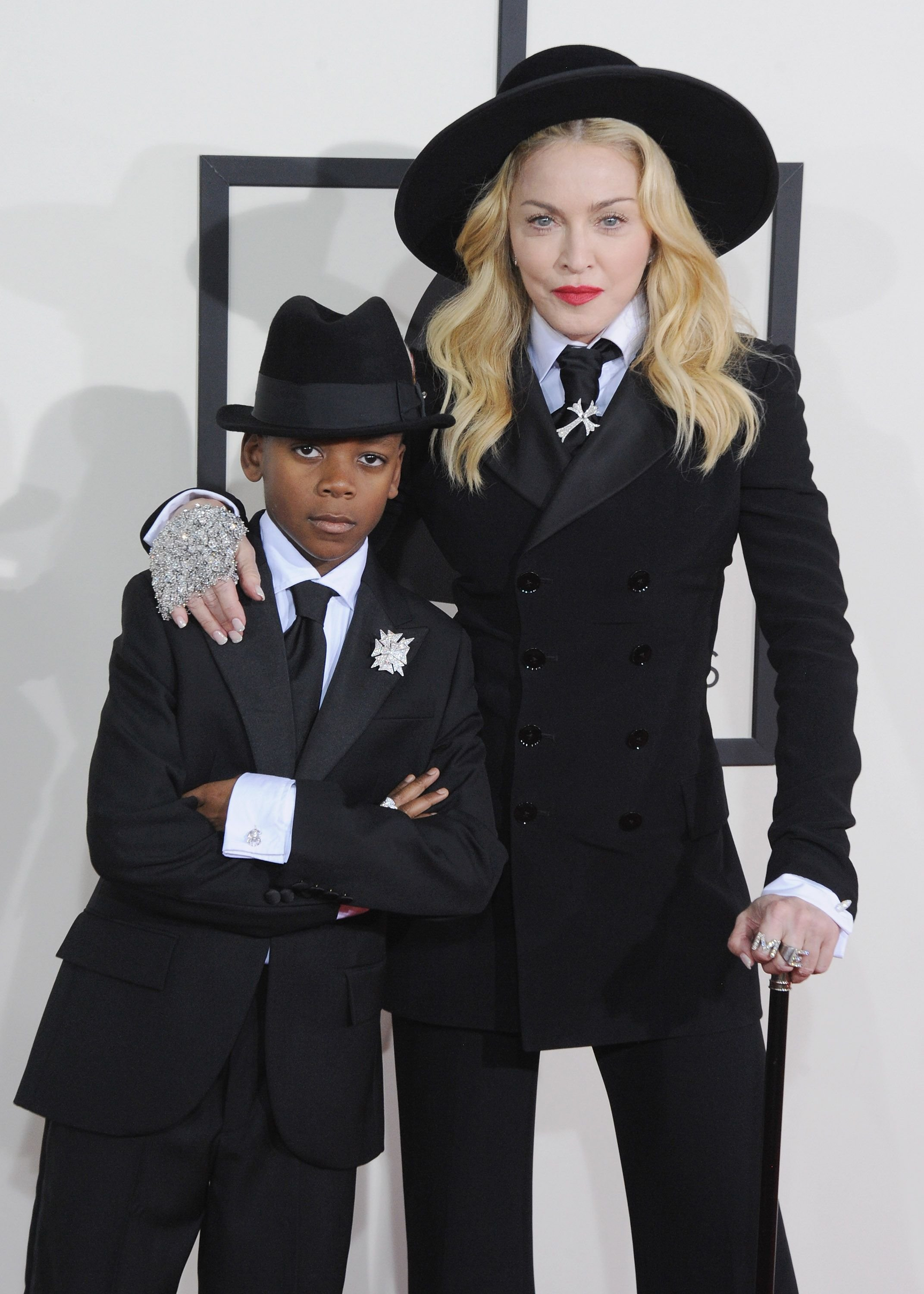 Madonna and her son David Banda Mwale Ciccone Ritchie at the 56th Grammy Awards at Staples Center on January 26, 2014, in Los Angeles, California | Photo: Jon Kopaloff/FilmMagic/Getty Images