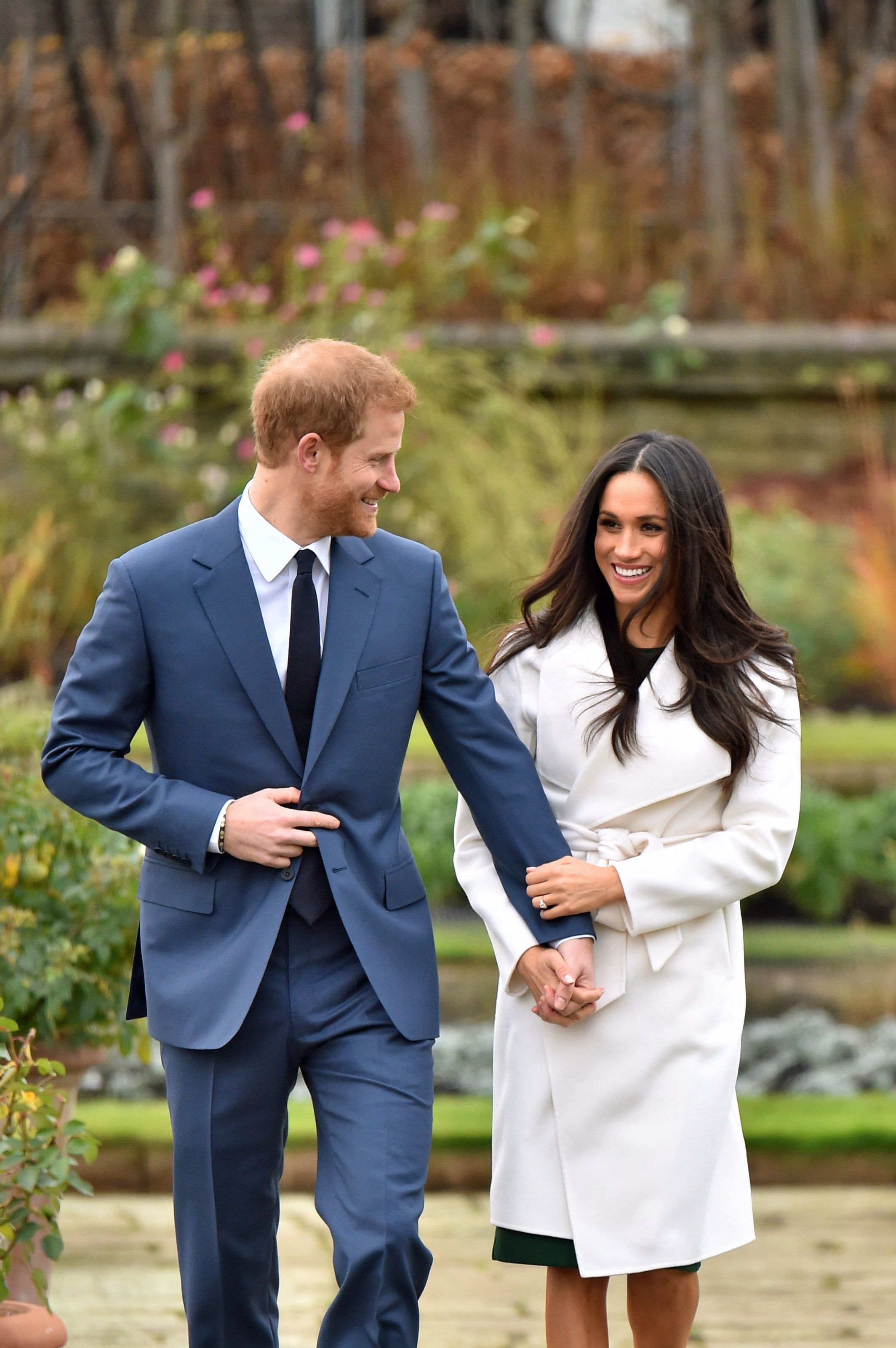 Prince Harry and Meghan Markle in the Sunken Garden at Kensington Palace, London, after the announcement of their engagement. | Source: Getty Images