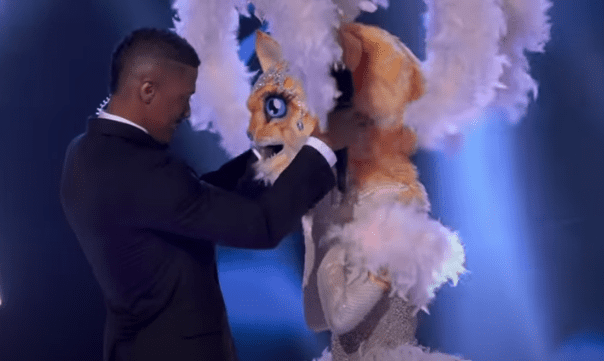 "Nick Cannon helps the Kitty with the big reveal on the third season of ""The Masked Singer,"" on May 6, 2020. 