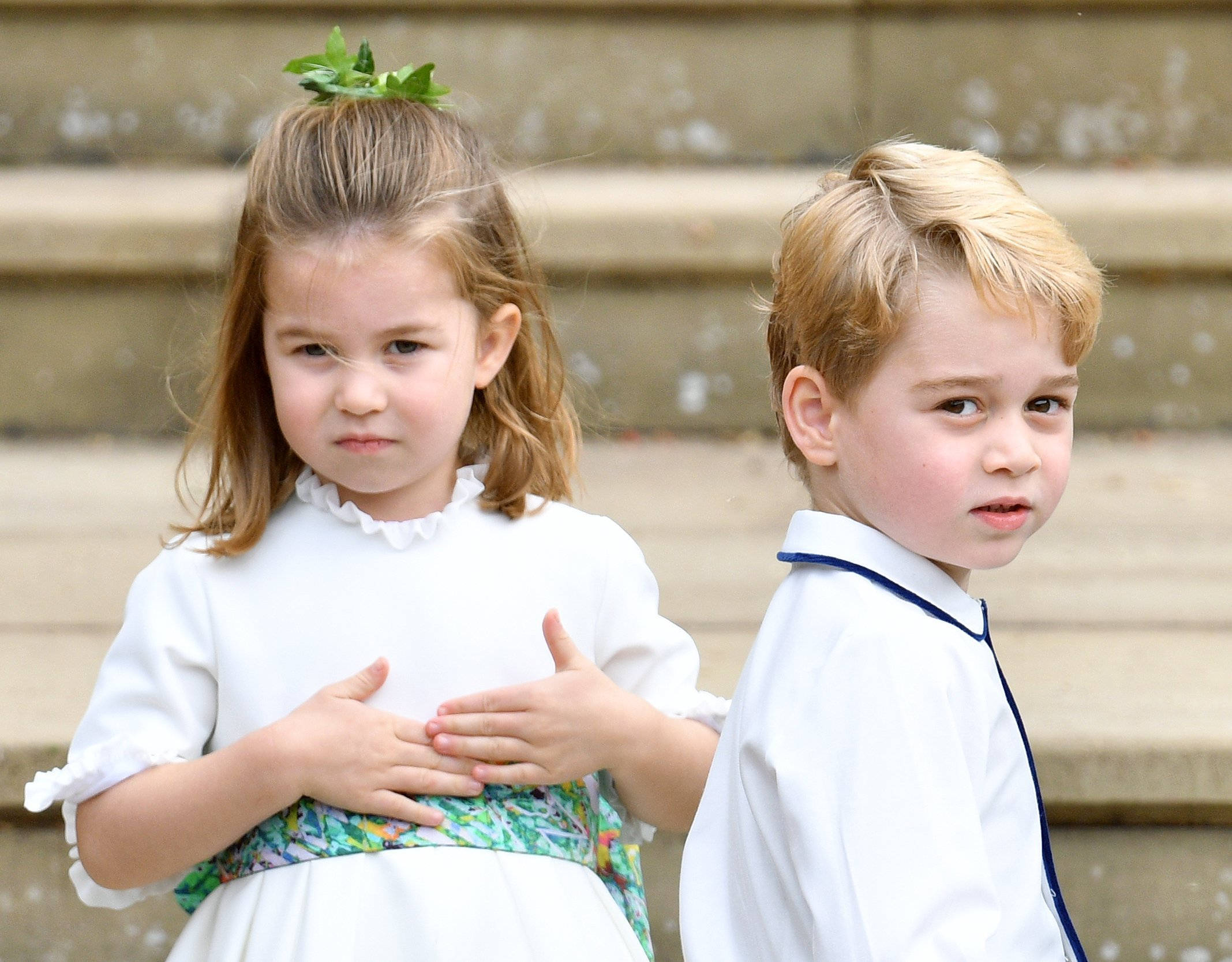 Princess Charlotte and Prince George outside St George's Chapel  at the wedding of Princess Eugenie and Jack Brooksbank | Photo: Getty Images