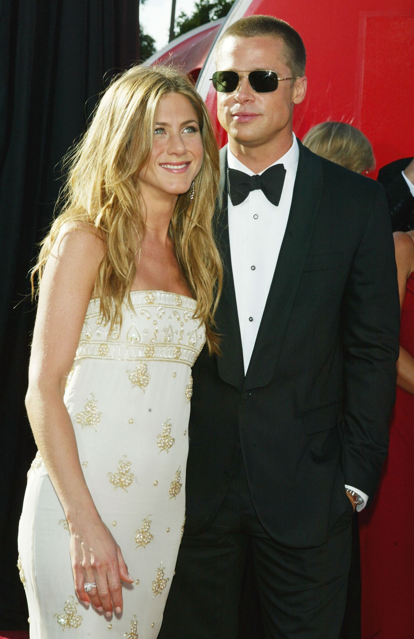 Actors Jennifer Aniston and husband Brad Pitt attend the 56th Annual Primetime Emmy Awards at the Shrine Auditorium | Getty Images