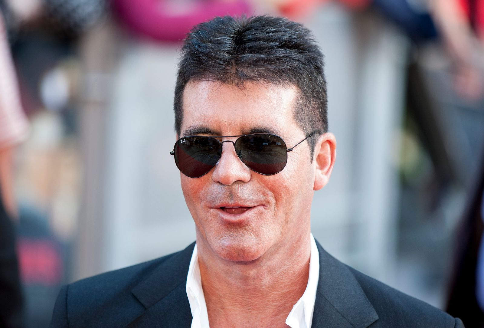 """Entertainment producer Simon Cowell attend the 2013 world premiere of """"One Direction"""" in London. 