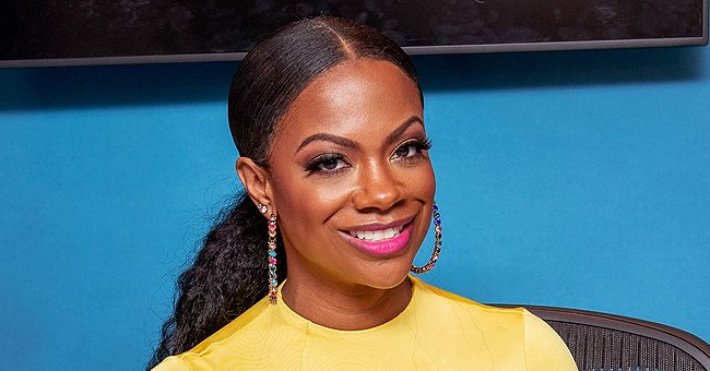 Kandi Burruss' Stepdaughter Kaela Flaunts Her Abs in a White Crop Top and Red Pants in a Photo