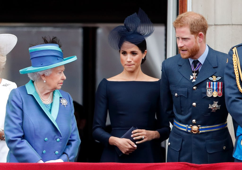 Queen Elizabeth II, Meghan Markle, and Prince Harry in 2018 in London, England | Photo: Getty Images