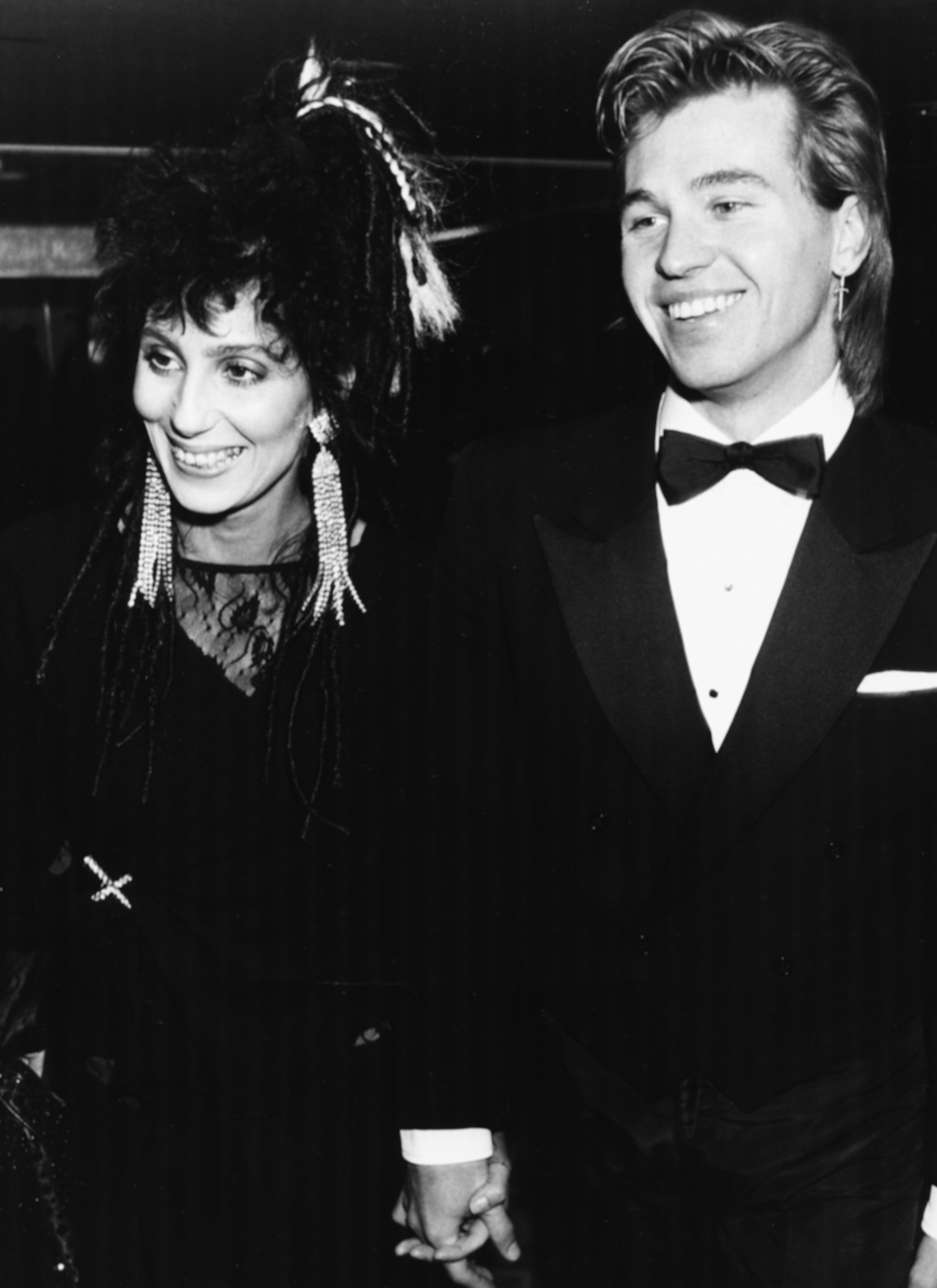 Singer Cher and actor Val Kilmer attending the BAFTA Awards hand in hand, London, March 25, 1984. | Source: Getty Images.