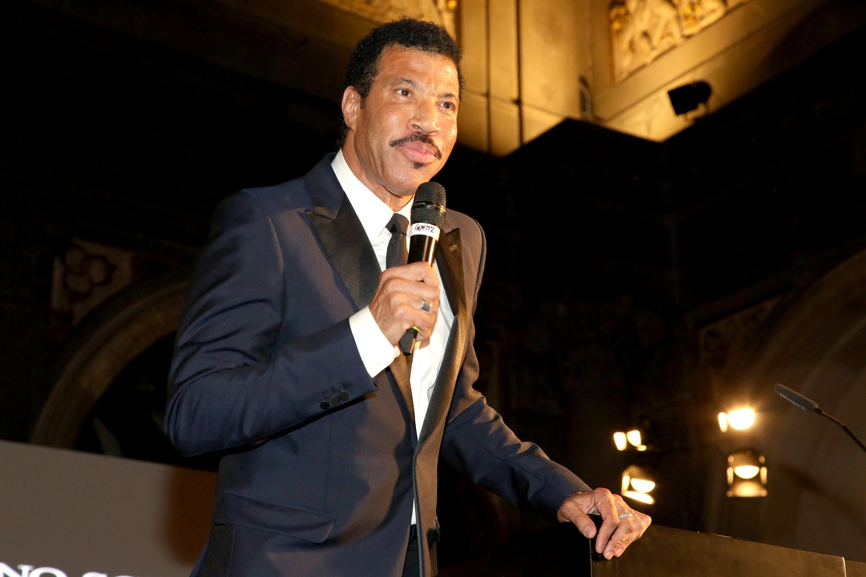 Lionel Richie accepts award during the Celebrity Fight Night gala celebrating Celebrity Fight Night In Italy benefitting The Andrea Bocelli Foundation and The Muhammad Ali Parkinson Center on September 7, 2014 | Photo: Getty Images