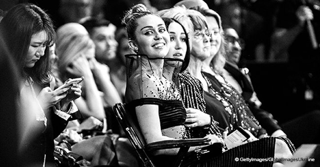 Miley Cyrus provokes fans in sheer strapless dress with a bizarre box instead of neckline