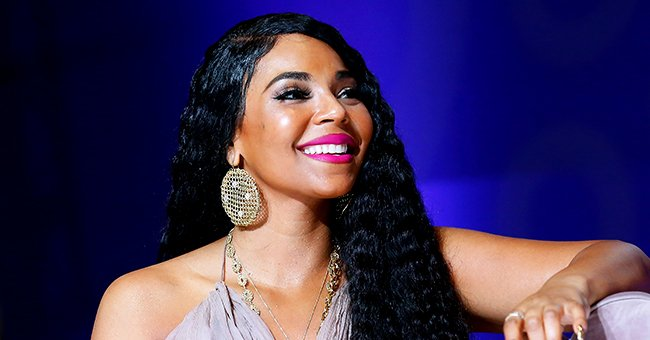 Check Out Ashanti at the Age of 40 Showing Her Fit Figure in Gold Bikini & Colorful Cover Up