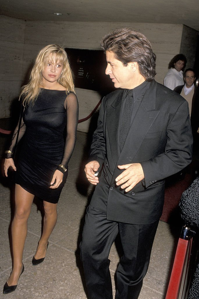 "Pamela Anderson and Jon Peters attend the premiere of ""Glory"" on December 11, 1989, Los Angeles 
