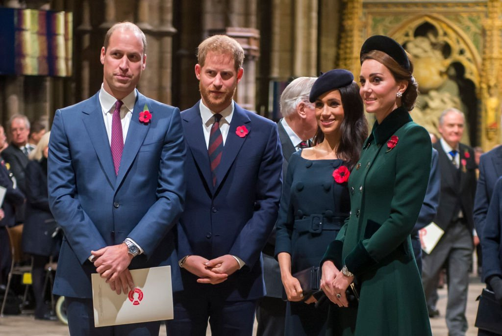 Prince William,Kate Middleton, Prince Harry and Meghan Markle stand next to a wreath of flowers at service for the WW1armistice at Westminster Abbey on November 11, 2018, in London, England | Photo: Getty Images