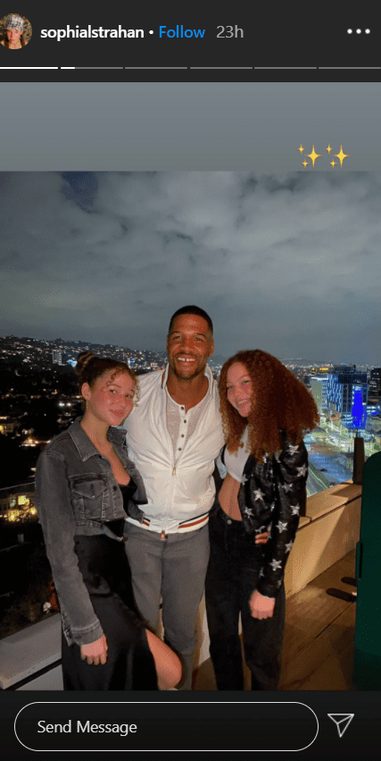 Michael Strahan hugging his twin daughters in a photo.   Photo: Instagram/Sophialstrahan