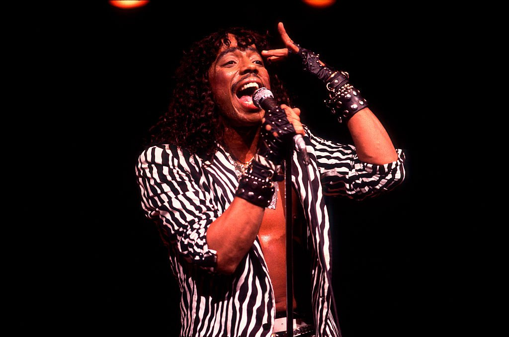 Rick James (born James Johnson Jr, 1948 - 2004) performs onstage at the Holiday Star Theater, Merrillville, Indiana, September 9, 1983 | Photo: Getty Images