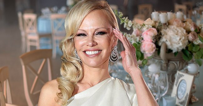 Pamela Anderson's Modified Classic Wedding Look — Blue Vintage Dress with Rain Boots Underneath