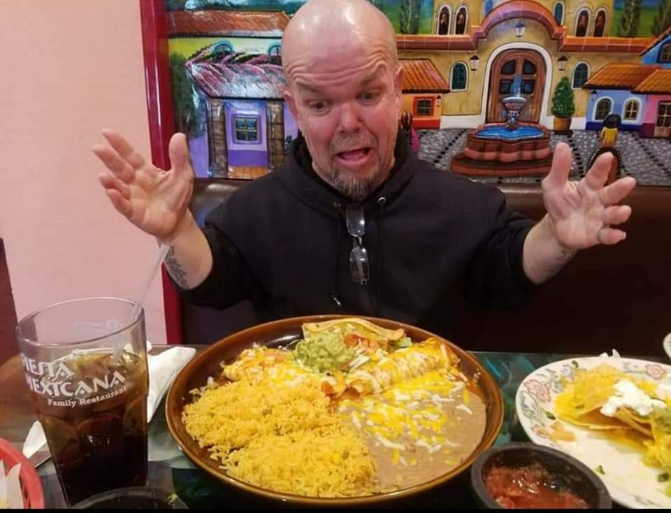 """""""Jackass 3D"""" and """"Oz: The Great and Powerful"""" actor Stevie Lee Richardson posing with a plate of foot at a Fiesta Mexicana restaurant 