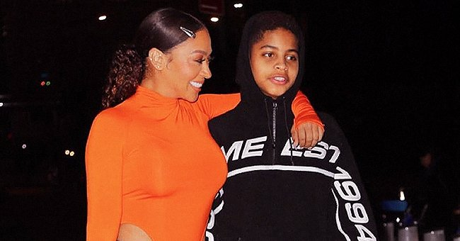 La La Anthony of 'Power' Fame Poses with Her Son Kiyan as She Rocks Orange Bodysuit & Black Latex Pants in Photos