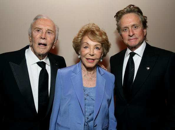 Kirk Douglas, Anne Buydens and Michael Douglas on February 22, 2009 in West Hollywood, California | Photo: Getty Images