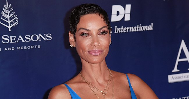 Check Out Nicole Murphy Bonding with Granddaughter Evie in Adorable White Ensemble & Sunglasses