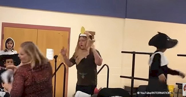 Boy with autism bursts out crying on stage when teacher snatches the microphone away