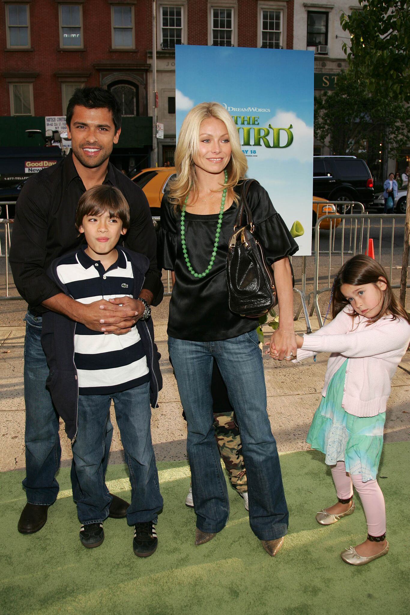 Mark Consuelos and Kelly Ripa pose with their children Michael Joseph and Lola Grace at the premiere of Shrek The Third | Getty Images