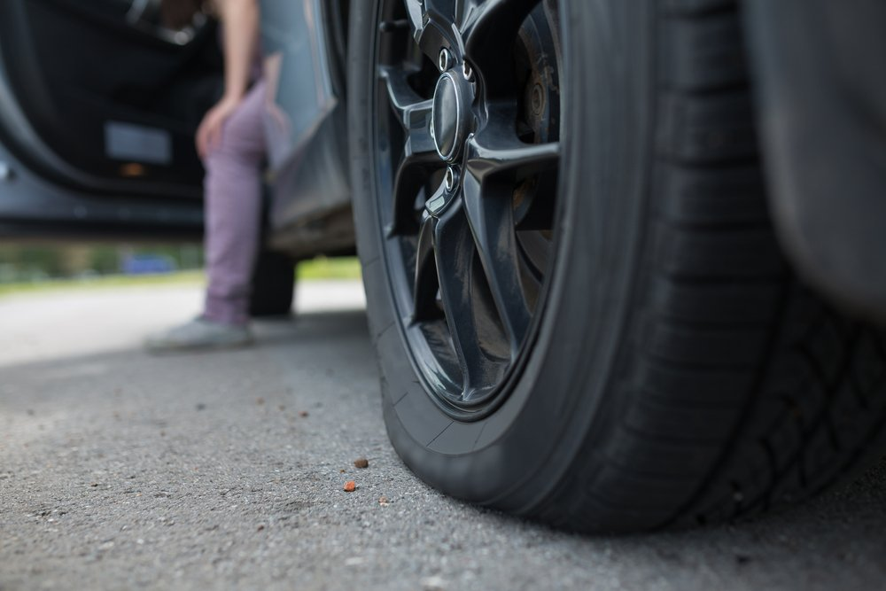 A Texan with a flat tire and no idea what to do   Photo: Shutterstock