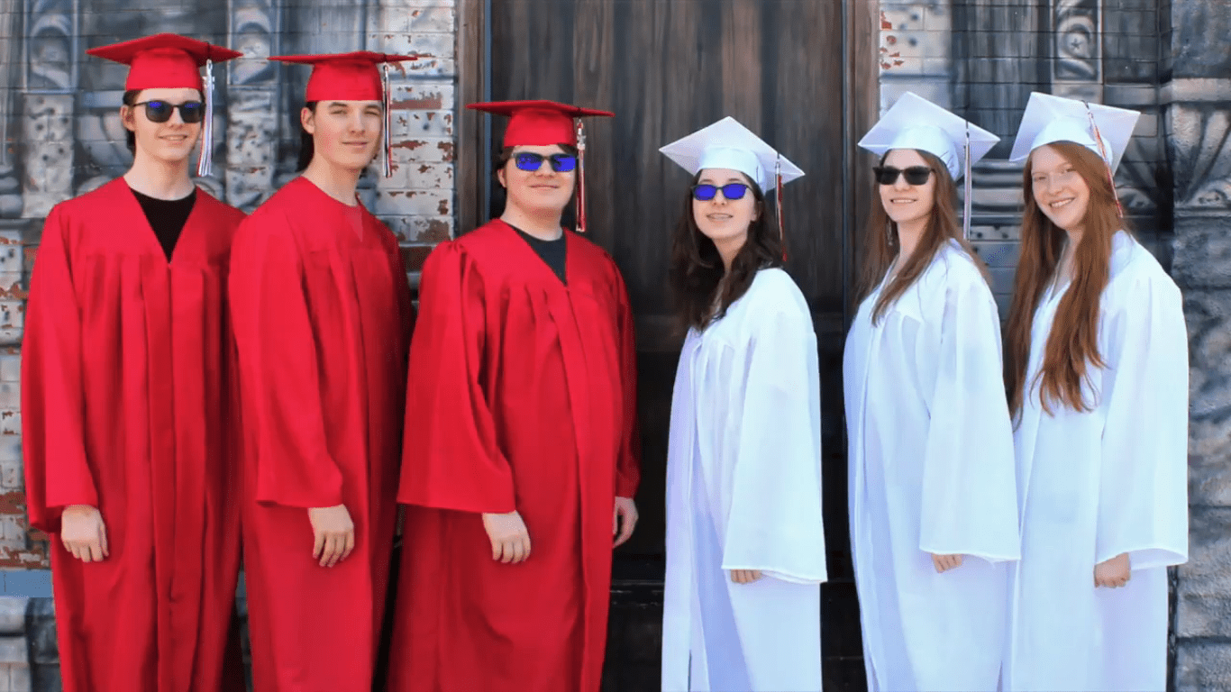 The Headrick sextuplets in their graduation gown |  Photo: facebook/wichitaeagle