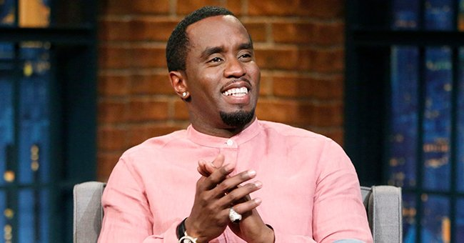 Diddy's Twins Pose In Matching Braids & Neon Orange Outfits While Walking Dogs in New Snaps