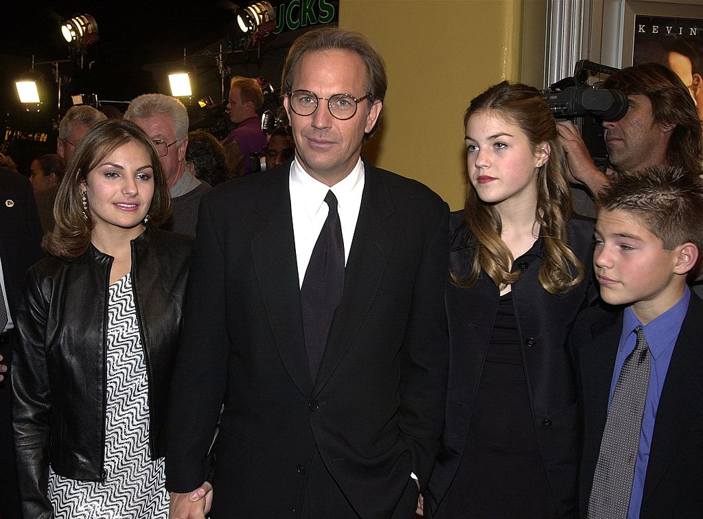 "Kevin Costner and his children Lily, Annie and Joe at the premiere of ""Thirteen Days"" December 19, 2000 