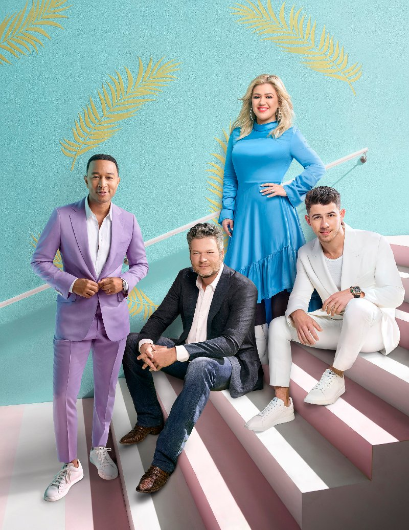 "John Legend, Blake Shelton, Kelly Clarkson, and Nick Jonas posing for a promotional photo for ""The Voice"" season 18 in November 2019. 