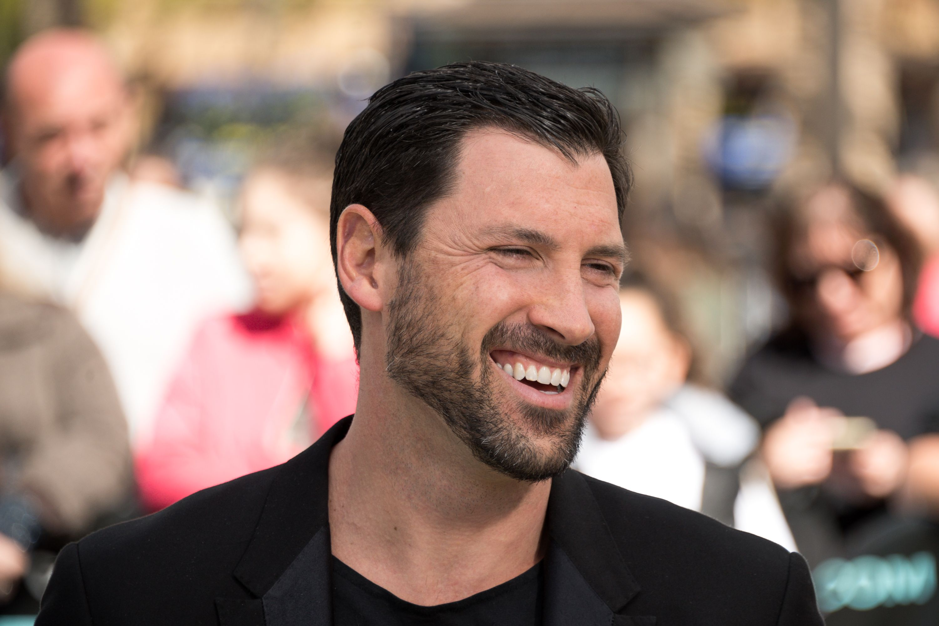 """Maks Chmerkovskiy visited """"Extra"""" at Universal Studios Hollywood on February 19, 2018 in Universal City, California   Photo: Getty Images"""