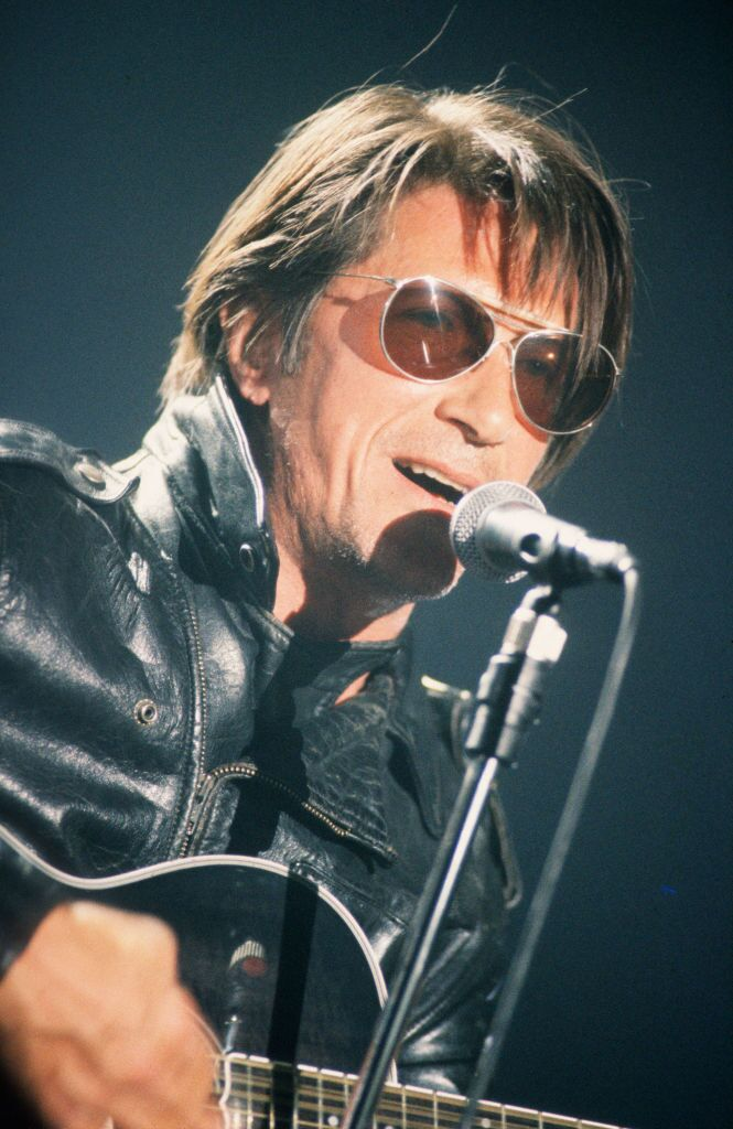 Jacques Dutronc au concert lors du Vorst Nationaal, Bruxelles, Belgique, 20 avril 1993. | Photo : Getty Images