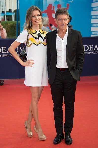 Antonio Banderas and Nicole Kimpel posing during the 43rd Deauville American Film Festival on September 6, 2017. | Source: Getty images