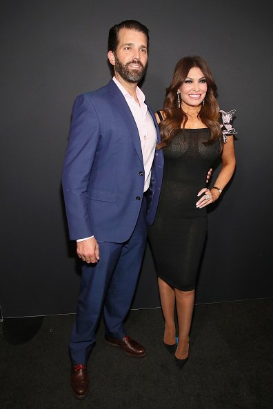 Kimberly Guilfoyle and Donald Trump Jr. pose backstage for Zang Toi fashion show during New York Fashion Week: The Shows at Gallery II at Spring Studios on February 13, 2019 in New York City | Photo: Getty Images