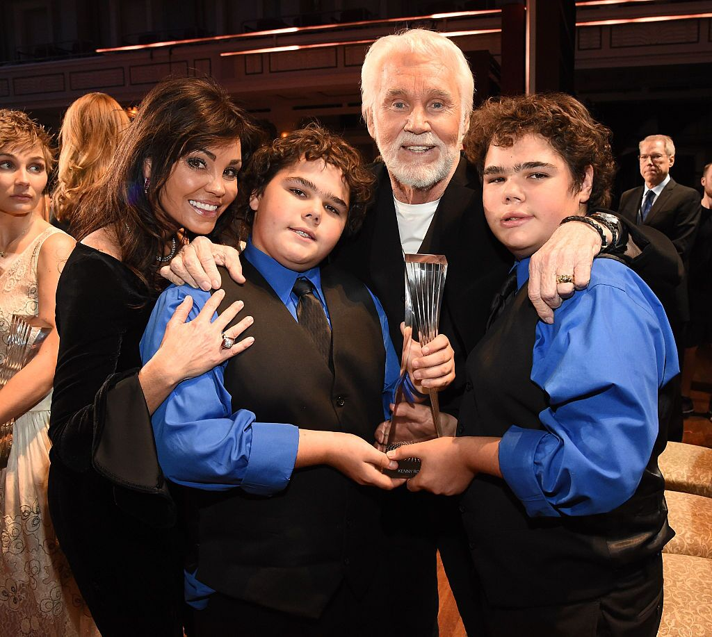"Kenny Rogers with wife Wanda Miller and their twin sons at the 2015 ""CMT Artists of the Year Awards"" in Nashville 