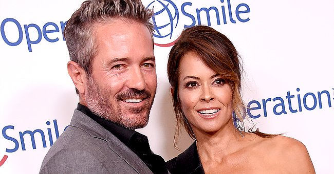 A portrait of Brooke Burke and Scott Rigsby | Photo: Getty Images