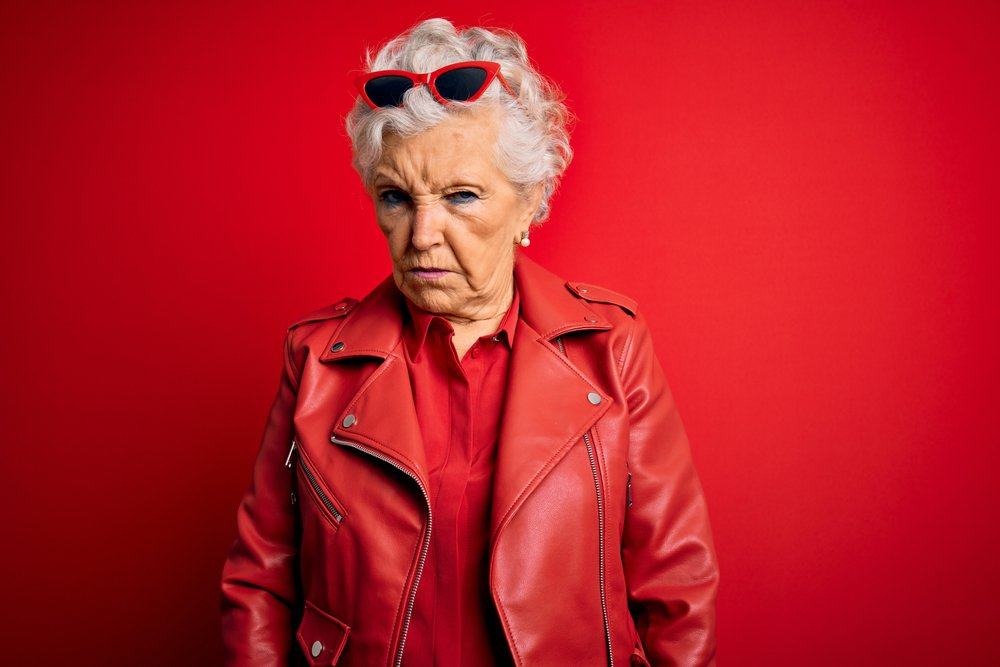A photo of a senior woman frowning her face. | Photo: Shutterstock.