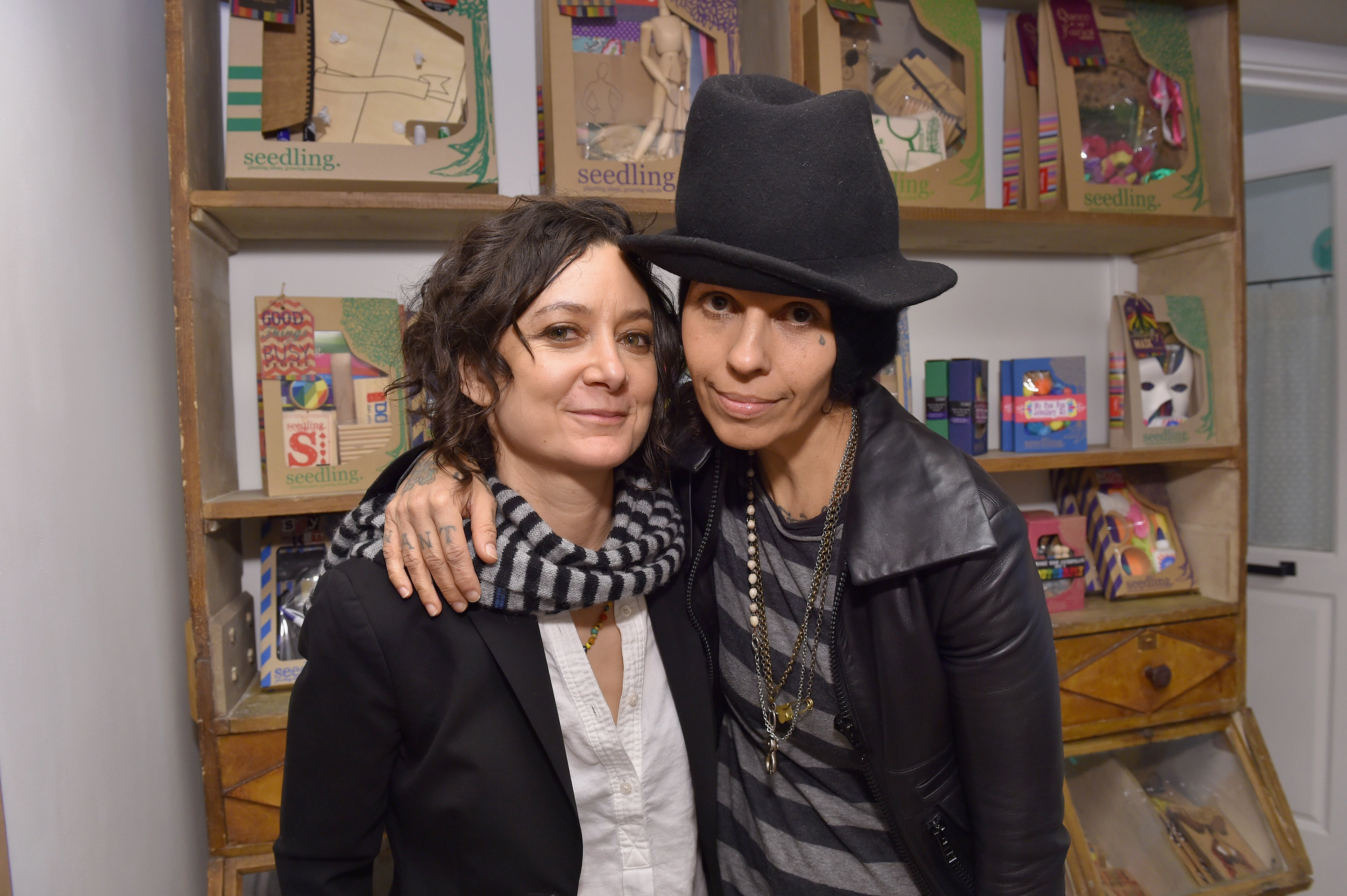 Sara Gilbert and singer Linda Perry attend the Grand Opening Of Au Fudge, Presented By Amazon Family on March 1, 2016, in West Hollywood, California. | Source: Getty Images.