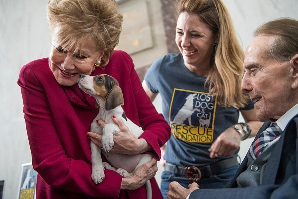 Former Sen. Bob Dole, R-Kan., and his wife former Sen. Elizabeth Dole, R-N.C., attend the Paws for Love, Valentines Day animal adoption event in February 14, 2017