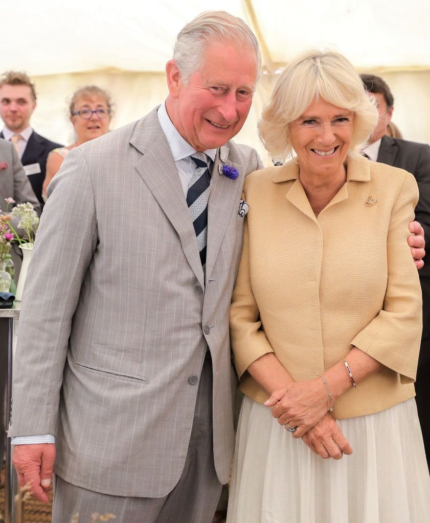 Camilla, Duchess of Cornwall and Prince Charles, Prince of Wales and the crowds gathered at the National Parks uring an official visit to Devon & Cornwall on July 17, 2019 in Simonsbath, England   Photo: Getty Images