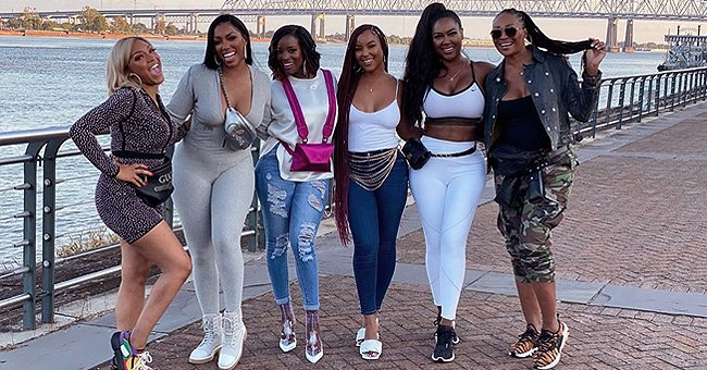 Kenya Moore Shows off Her Fit Figure Posing with RHOA Members in a White Top and Tight Leggings